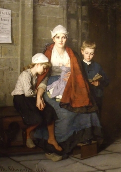 A woman with her three children at church