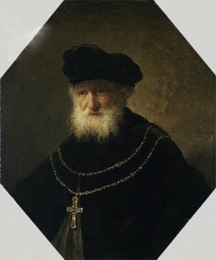 Bust of a man wearing a golden chain with a cross