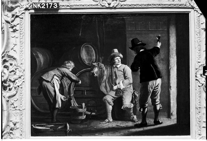 Drie mannen in een wijnkelder
