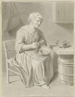 Etende vrouw in interieur
