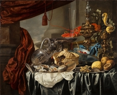 Opulent Still-Life with Silvergilt objects, Nautilus Shell, Porcelain, Pie, Fruit and Fish on a Draped Table
