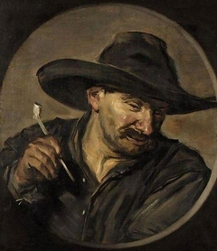 Portrait of a man in a hat holding a pipe