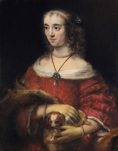 Portrait of a woman with a lap dog