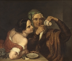 Two women with a cup