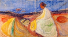 Woman in White Sitting on the Beach