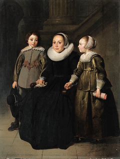 Portrait of a seated woman and two children