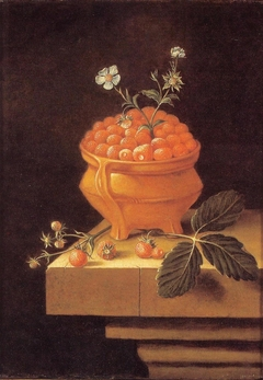 Still life with a bowl of strawberries on a stone table