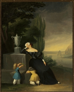 Widow with a child at her husband's grave