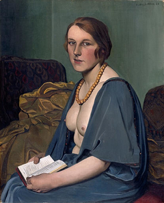 Woman reading nude