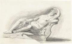 Beeld van naakte vrouw, liggend op een bankkussen