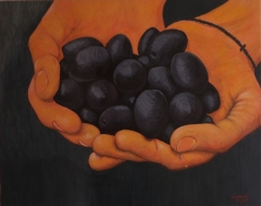 Hands with olives