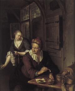 Interieur met man die een pijp stopt en een vrouw met kan