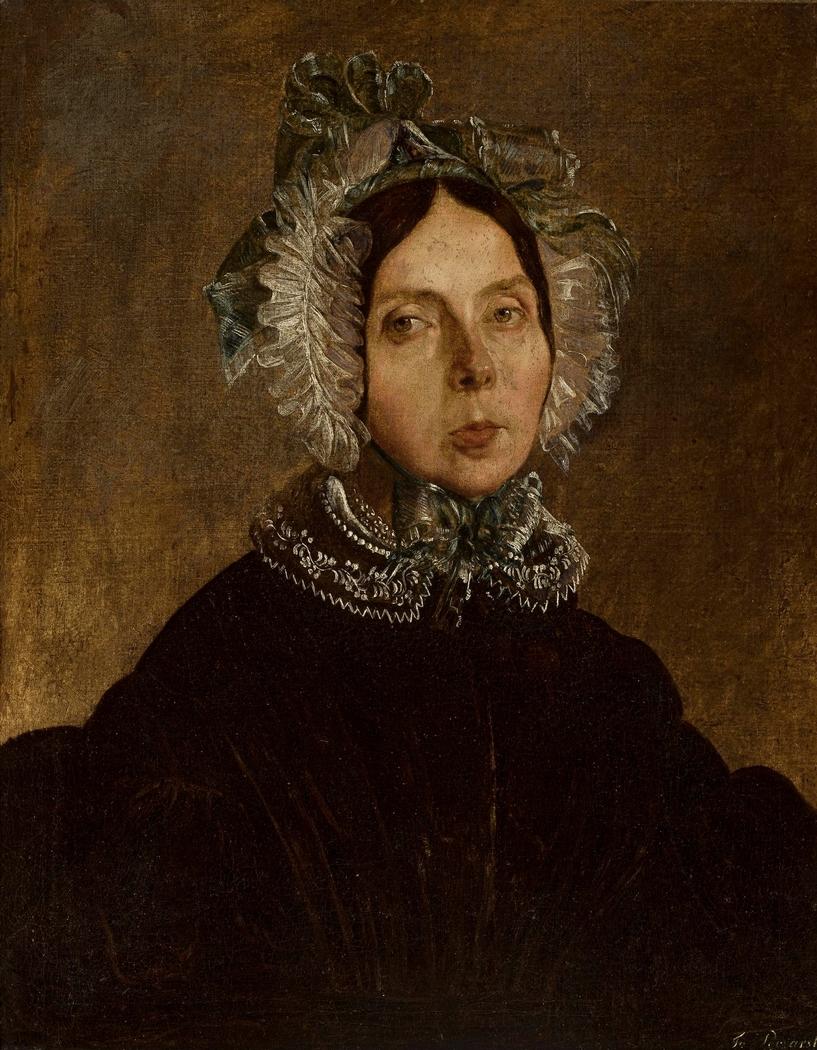 Portrait of a woman in a lace bonnet.