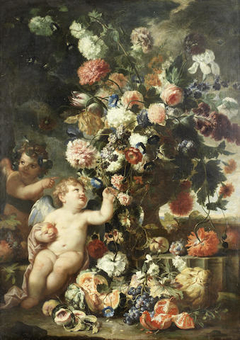 Roses, carnations, tulips and other flowers in a carved stone vase with putti on a stone ledge with split melons, grapes, peaches and other fruit