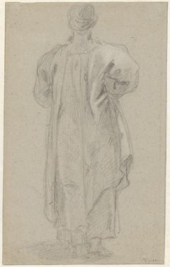 Staande man met tulband, op de rug gezien