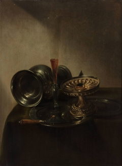 Still life with lying jar, flute-glass and tazza