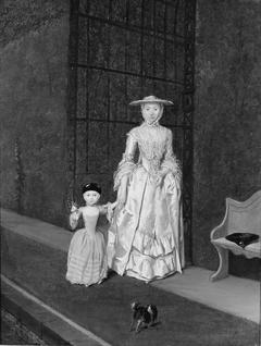 Vrouw en kind in tuin