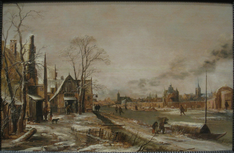 A Village Scene in Winter with a Frozen River