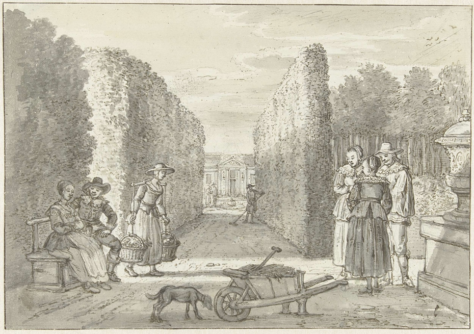 Diverse personen in een tuin met hoge hagen