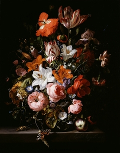 Flowers in a glass vase on a marble table