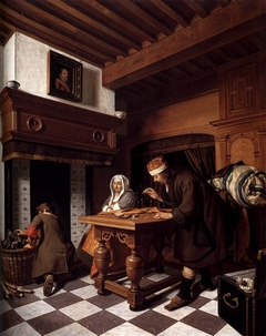Goldweigher with a woman and a boy in an interior beside the fireplace