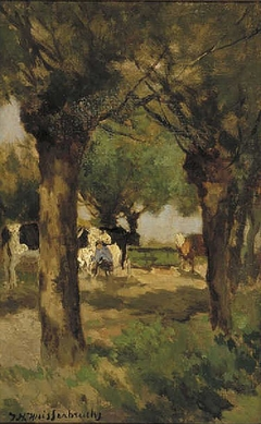 Milking cows amidst willow trees