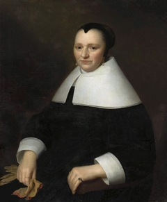 Portrait of a woman with gloves.