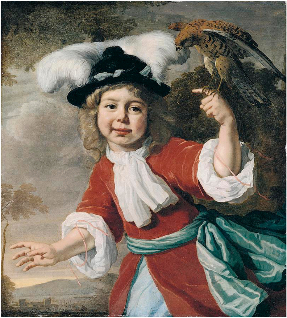 Portrait of a young boy with a falcon