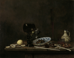 Still life with wineglass, flute, glass, earthenware jug and pipes