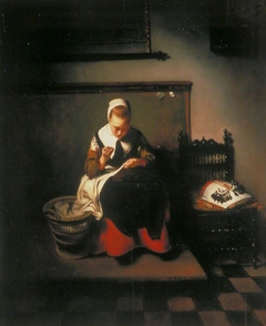 A Young Woman Sewing