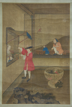 European Couple and Child Playing with Parrot