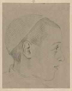 Hoofd van jongen met een kapje op, en profil naar rechts