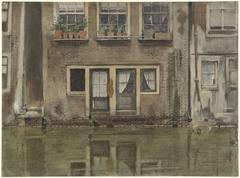 Huizen aan een gracht te Amsterdam