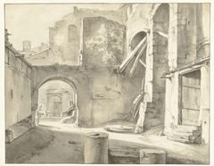 Italiaanse gebouwen met links een poort