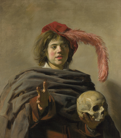 Portrait of a young man with a skull