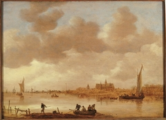 River landscape with a town beyond