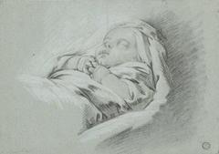 Slapende baby, de handjes over elkaar