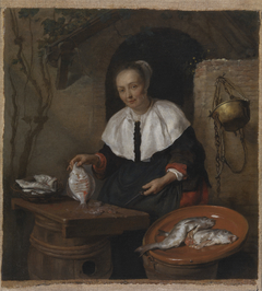 Woman cleaning fish
