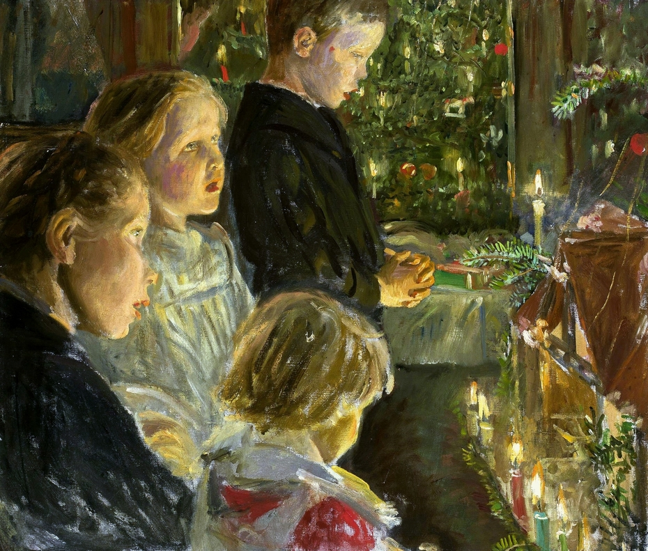 Children by the Christmas tree.