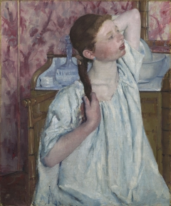 Girl Arranging Her Hair