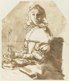 Jonge vrouw zittend aan tafel