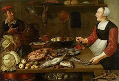 Kitchen interior with a female cook.