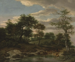 Rolling wooded landscape with cattle on a flooded road