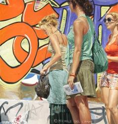 Three girls standing by graffiti
