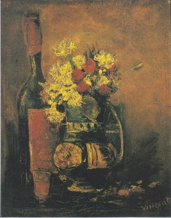 Vase of white carnations and roses and bottle