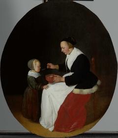 A Mother Feeding Porridge to her Child