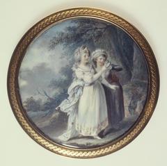 Deux femmes dans un parc regardant un médaillon