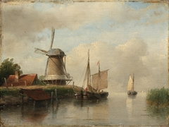 Dutch ships moored on a river beside a windmill