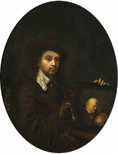 Rembrandt holding a portrait of his father