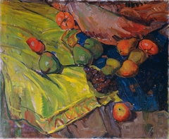 Still-life with fruits on green cloth